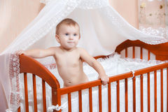 Baby in a children's bed Stock Photography