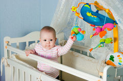 Baby in children's to a bed Royalty Free Stock Images