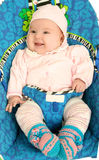 Baby  in childs armchair Stock Image