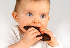 Baby with chocolate Stock Photography
