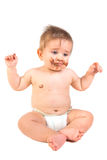 Baby with chocolate Royalty Free Stock Photography
