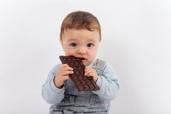 Baby and the chocolate royalty free stock image