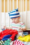 Baby chooses clothes for walk Royalty Free Stock Image