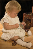 Baby choosing accessory Royalty Free Stock Photography