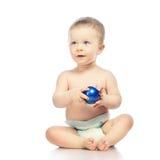 Baby With Chrismas Ball Royalty Free Stock Image