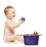 Baby With Chrismas Balls Royalty Free Stock Photo