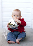 Baby at Christmas. A cute baby boy playing with Christmas decorations Stock Photography