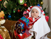Baby at Christmas. Christmas baby in sleigh with Christmas Tree Stock Photos