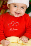 Baby at Christmas. Baby in a Christmas hat with a great smile royalty free stock photo
