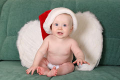 Baby christmas angel. With red hat Stock Photography
