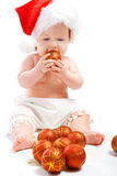 Baby with Christmas balls Stock Photo