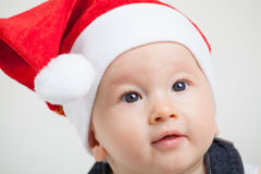 Baby with christmas cap Royalty Free Stock Image