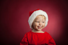 Baby in a Christmas cap Stock Photography