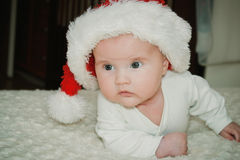 Baby in a christmas cap Stock Photo