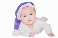 Baby in a christmas cap Royalty Free Stock Image