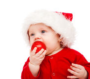 Baby with Christmas decoration Stock Images