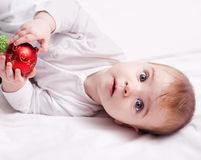 Baby with christmas decoration Stock Photo