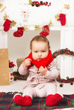 Baby in Christmas decorations Royalty Free Stock Image