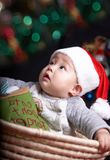 Baby at christmas eve Royalty Free Stock Image