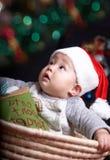 Baby at christmas eve. Baby in santa hat at christmas eve Royalty Free Stock Image