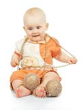 Baby with christmas garland and gold balls Stock Photo