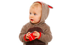 Baby with Christmas gift box looking in corner Stock Photo