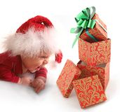 Baby and Christmas gift Stock Images