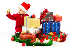 Baby with christmas gifts. Santa helper baby with christmas gifts width white background Royalty Free Stock Image