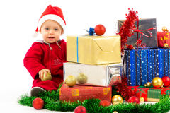 Baby with christmas gifts Royalty Free Stock Photos