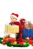 Baby with christmas gifts. Santa helper baby with christmas gifts width white background Stock Photography