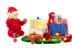 Baby with christmas gifts. Santa helper baby with christmas gifts width white background Stock Images