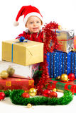 Baby with christmas gifts. Santa helper baby with christmas gifts width white background Stock Photo
