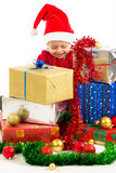 Baby with christmas gifts. Santa helper baby with christmas gifts width white background Royalty Free Stock Photos