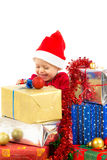 Baby with christmas gifts. Santa helper baby with christmas gifts width white background royalty free stock images