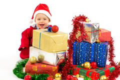 Baby with christmas gifts. Santa helper baby with christmas gifts width white background Stock Image