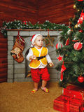 Baby Christmas gifts and Christmas tree. Child standing near Christmas tree beneath which lie gifts Stock Photos