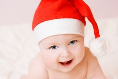 Baby in christmas hat Stock Image