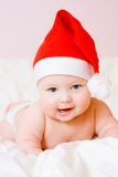 Baby in christmas hat Royalty Free Stock Image