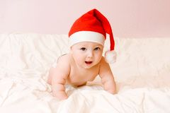 Baby in christmas hat Royalty Free Stock Images