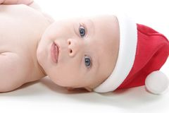 Baby in Christmas Hat Stock Photo
