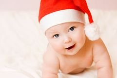Baby in christmas hat Stock Photos