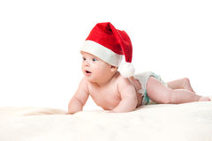Baby in Christmas hat laying on blanket Royalty Free Stock Photo