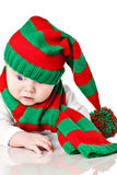 Baby with christmas hat and scarf Royalty Free Stock Photo