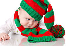 Baby with christmas hat and scarf Royalty Free Stock Images