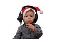 Baby christmas with headphones Stock Images