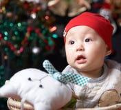 Baby at christmas night. A cute asian baby boy at christmas night Royalty Free Stock Photos
