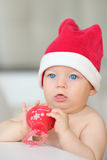 Baby christmas portrait in Santa Claus hat Stock Photos