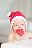 Baby christmas portrait in Santa Claus hat Royalty Free Stock Photos