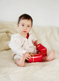 Baby with christmas presents Stock Images