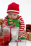 Baby and Christmas Presents royalty free stock images